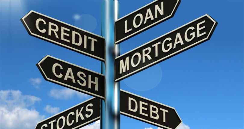 Debt and credit street sign